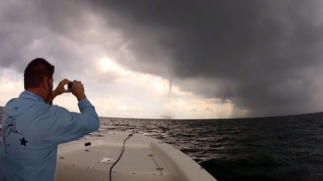 VIDEO: Kevin Johnson and his friend filmed themselves driving their boat through dangerous water spouts.