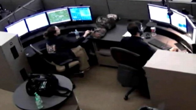 VIDEO:Video shows a 911 operator on her phone when she was supposed to be overseeing a trainee.