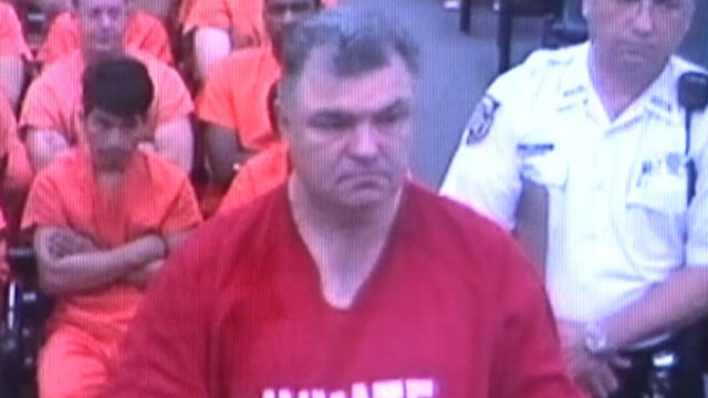 VIDEO: Teacher pulled out of his classroom for allegedly arranging colleagues murder.