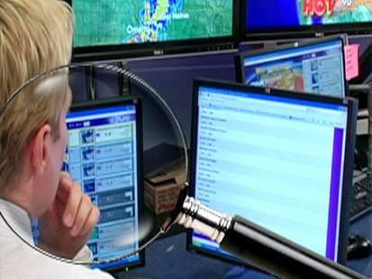 A picture of Sam Champion using the Self-Directed Search with a magnifying glass on top of the image.