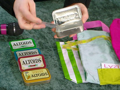 VIDEO: Sam Champion using Altoids cans as gift boxes.