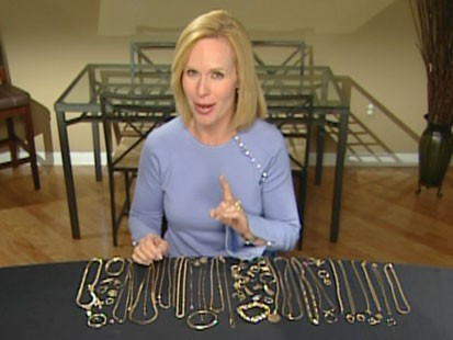A picture of Elisabeth Leamy and a table with gold jewelry on it.