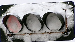 VIDEO: LED lights dont emit heat to melt snow on traffic lights, hiding signals.