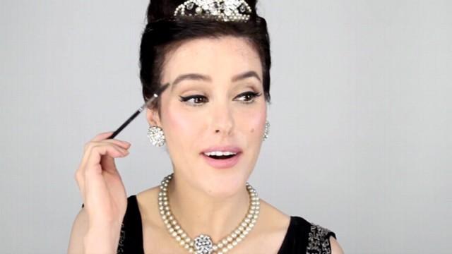 """VIDEO: Makeup artist demonstrates how to recreate Audrey Hepburns """"Breakfast at Tiffanys"""" look."""