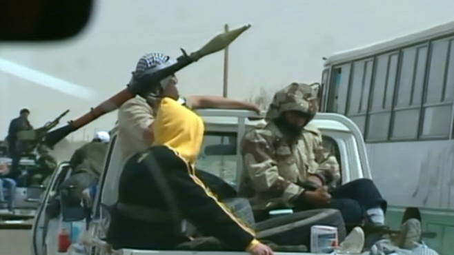 VIDEO: Footage shows rebels fleeing after ambush by Gadhafi forces.