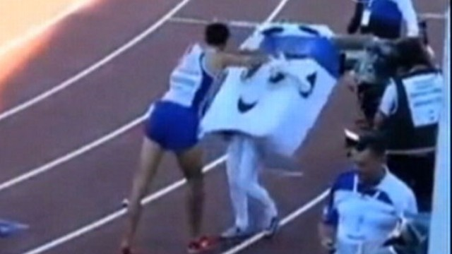 VIDEO: French Runner Wins Race, Shoves Mascot