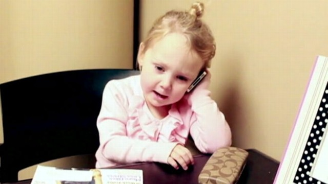 VIDEO: Toddlers take on the life and times of a busy, working gal goes viral online.