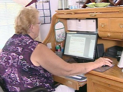 Old woman at a computer