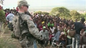 VIDEO: U.S. troops keep order on the ground so that aid can be distributed.