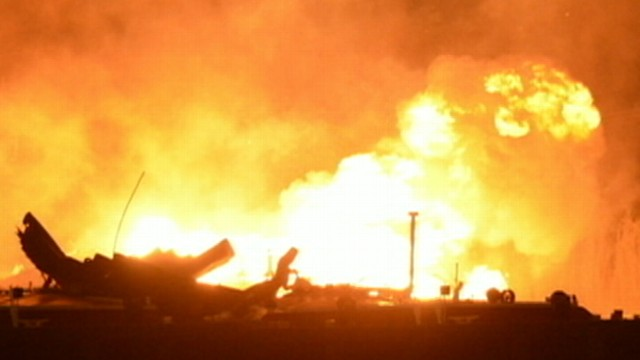 VIDEO: Investigators are trying to find out what caused seven explosions on two fuel barges.