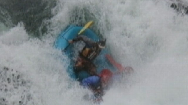 VIDEO: White water rafting guide jumped into action after one of his rafters went overboard.