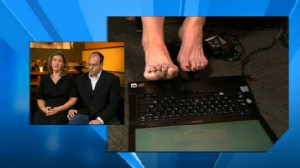 VIDEO: Woman tied to her bed by a burglar used her toes to type a message for help.