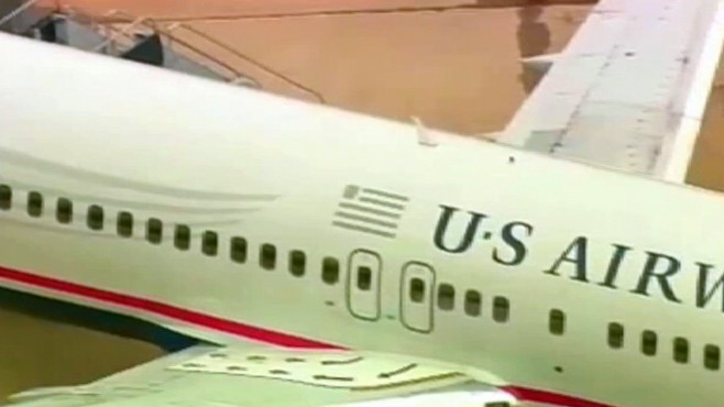 VIDEO: US Airways pilot discovers a hole in his plane before takeoff.