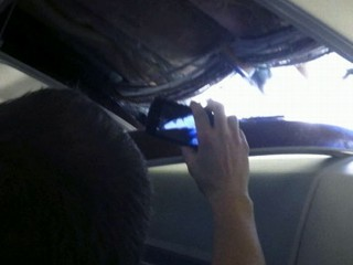 | Hole Rips in Roof of Plane |