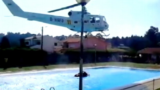European wildfires helicopter fighting wildfire refills for European pool show