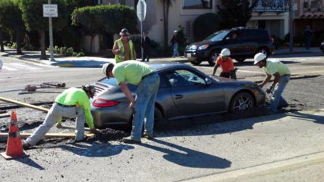 VIDEO: Driver trying to speed past a construction zone ends up stuck in wet cement.