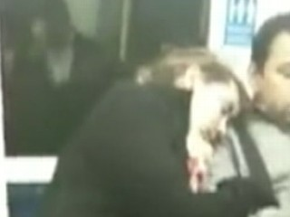 Watch: Sleepy Commuter Cuddles Stranger on the Train