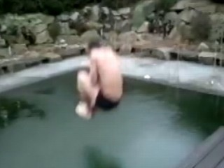 Watch: 'Ice Dude' Tries to Cannonball in Frozen Pool in YouTube Video