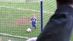 VIDEO: Soccer goalie's son slowly makes his way to the net during a teammate's farewell speech.