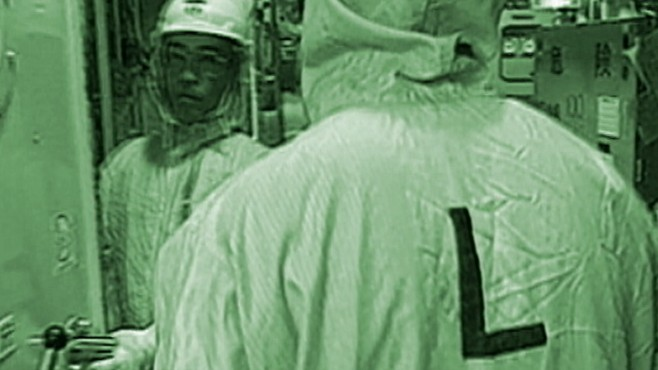 VIDEO: Firefighters spray down Fukushima reactor in hopes of preventing a meltdown.