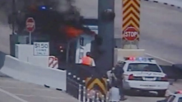 VIDEO: Dramatic video shows Texas driver rescued by a stranger near a toll booth.