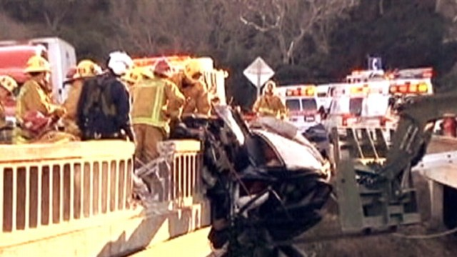 VIDEO: Rescue workers saved mother and two kids trapped in car hanging off a bridge.