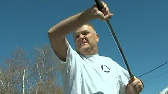 VIDEO: Kent Hendrix grabbed his sword and chased after a man mugging a woman outside his home.