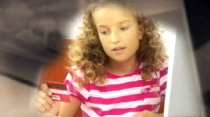 VIDEO: Parents debate the appropriate age to give their children credit cards.