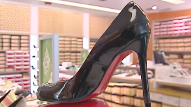VIDEO: At stake is the trademark red sole of designer shoes for woman.