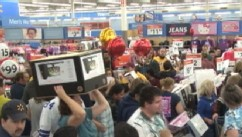 VIDEO: Consumers spent a record $52 billion over the Black Friday weekend.