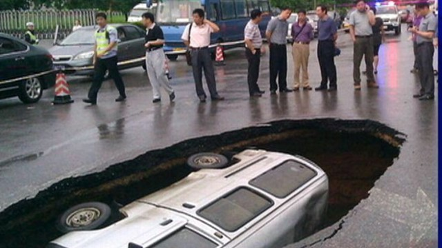 VIDEO: Watch what happened when a 6-foot deep sinkhole opened on a busy road.