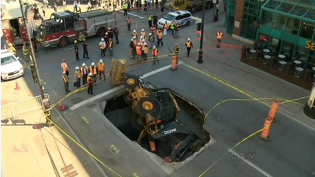 VIDEO: Sinkhole Swallows Backhoe
