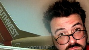VIDEO: Director Kevin Smith claims he was kicked off a flight for being too fat.