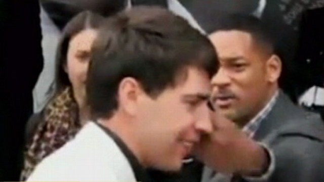 "VIDEO: Reporter got clocked as he tried to kiss the ""Men in Black"" Star."