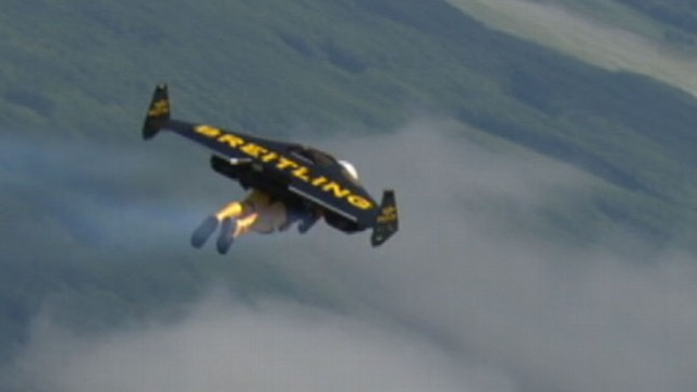 VIDEO: Yves Rossy wowed fans at an air show flying 4500 feet in his jet propelled wing suit.