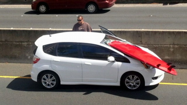VIDEO: Surfboard Pierces Drivers Windshield