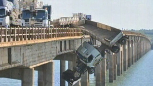 VIDEO: The driver hung off a bridge in Brazil for 30 minutes before being rescued.