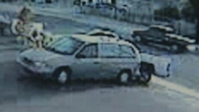 VIDEO: Child puts car in gear while mother is inside store shopping for groceries.