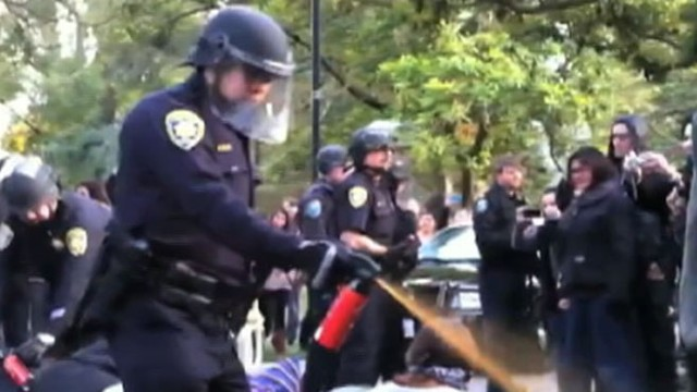 VIDEO: Two police officers were placed on leave after videos surfaced after protest.
