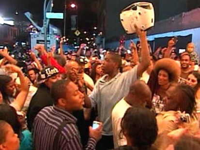 VIDEO: Crowds across the globe gather to listen to Michael Jackson music.
