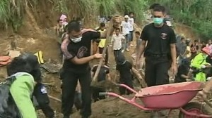 VIDEO: Indonesian Villagers Use Bare Hands to Dig Corpses