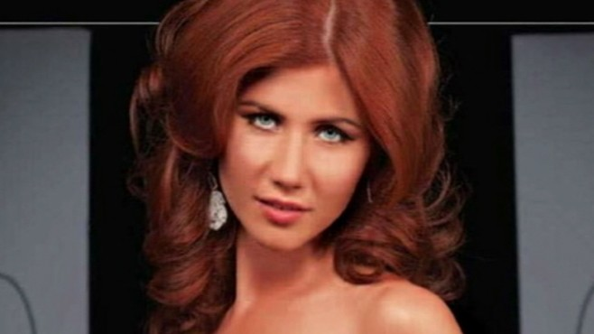 VIDEO: Flame-haired undercover agent appears in men's magazine.
