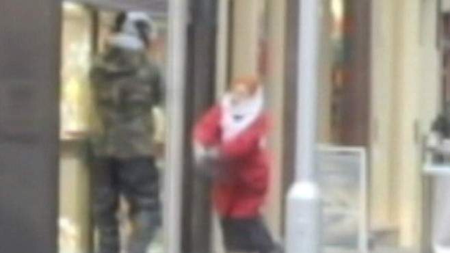 VIDEO: Elderly British woman stops jewelry store robbers with her purse.