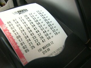Watch: Woman Finally Cashes in Winning Lotto Ticket