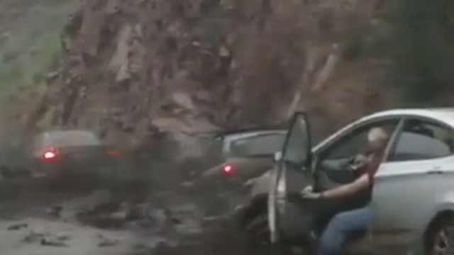 VIDEO: One person is dead and the search for another continues after flash floods hit Manitou Springs.