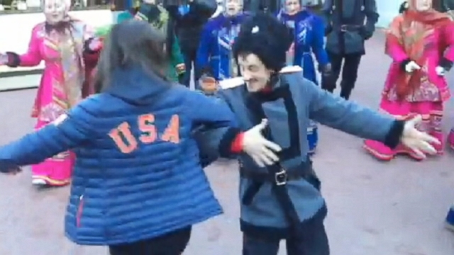 VIDEO: U.S. skiers Keri Herman and Devin Logan with Cossack dancers.