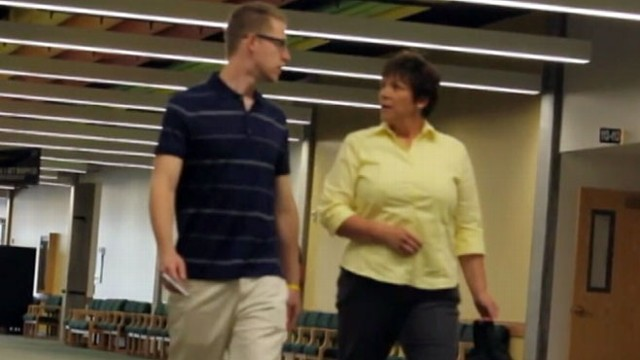 VIDEO: In a prank video, Andrew Hales goes up to total strangers and holds their hands.