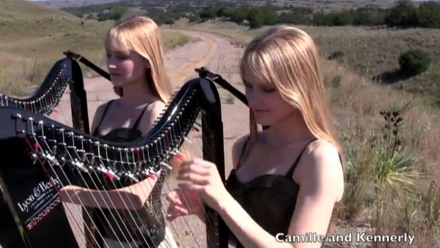 "VIDEO: Identical twins Camille and Kennerly Kitt play ""Sweet Child o Mine"" on their harps."