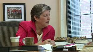 Janet Napolitano at her desk.