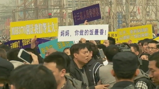 VIDEO: Chinese relatives demand that Malaysian officials share all satellite data regarding the missing plane.
